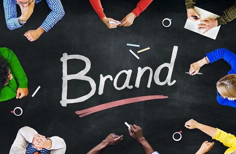 people sitting around the word brand