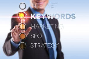 business man choosing the keywords option on a digital screen
