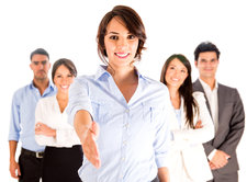 Business woman with hand extended to handshake - isolated over w
